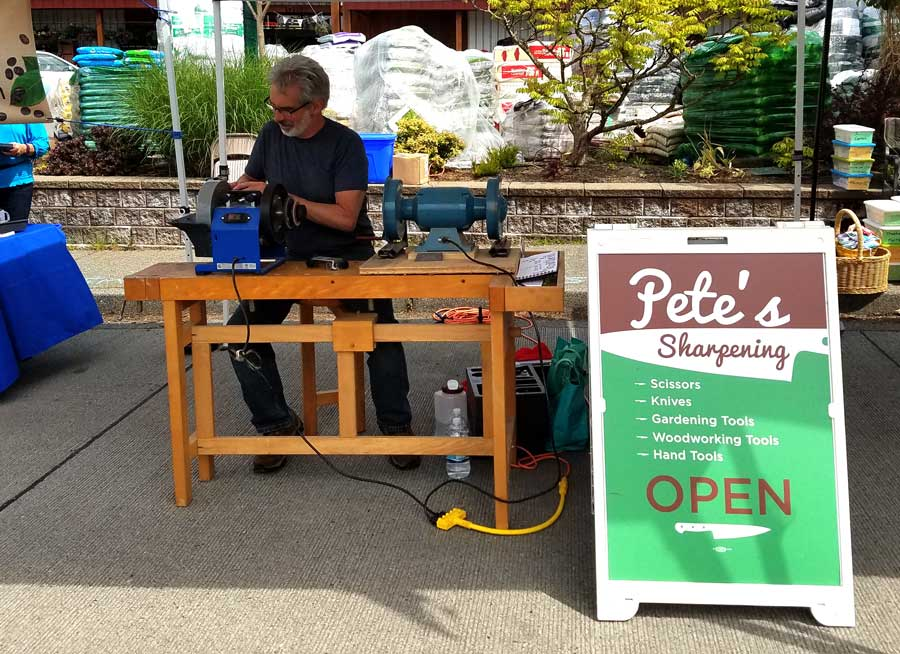 Pete sharpening at the farmer's market